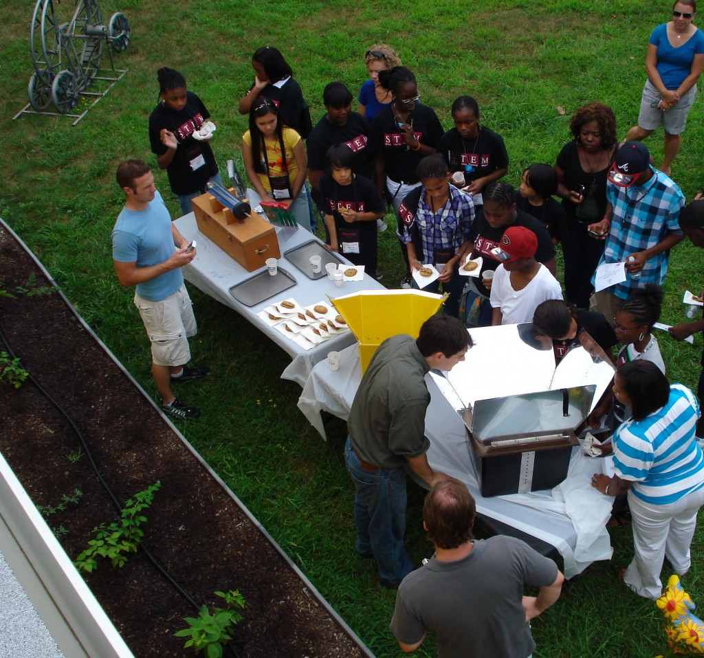 RPI STEM students learning about solar baked cookies!